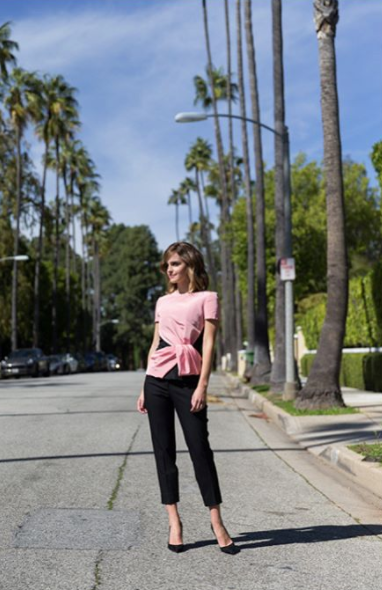 <p>Emma made on stylish arrival in LA, wearing Oscar de la Renta trousers and Burberry pumps, handmade in Italy. <em>[Photo: Instagram/The Press Tour]</em> </p>
