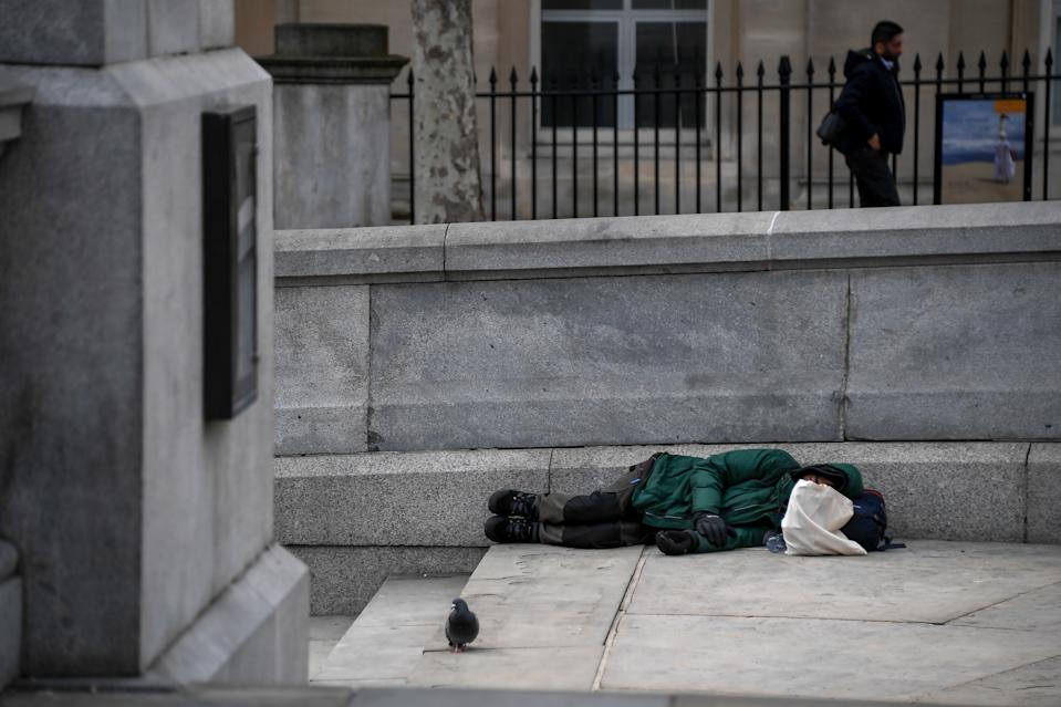 A homeless sleep on the steps of Trafalgar Square, on March 17, 2020 in London, England. Boris Johnson held the first of his public daily briefings on the Coronavirus outbreak yesterday and told the public to avoid theatres and pubs and to work from home where possible. The number of people infected with COVID-19 in the UK has passed 1500 with 55 deaths.  (Photo by Alberto Pezzali/NurPhoto via Getty Images)