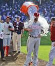 Philadelphia Phillies starter Cole Hamels gets doused after pitching a no-hitter against the Chicago Cubs in a baseball game in Chicago, Saturday, July 25, 2015. The Phillies won 5-0. (AP Photo/Matt Marton)