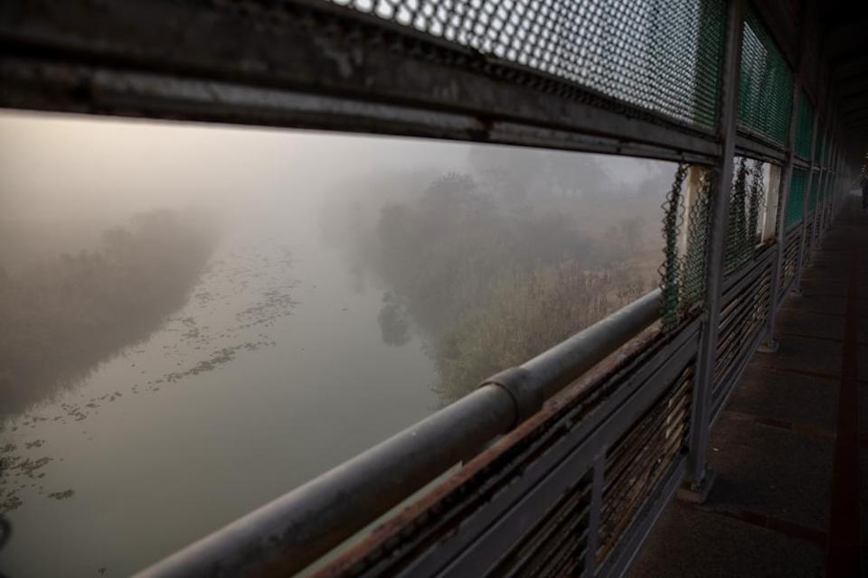 The Rio Grande flows under a dense fog at the US-Mexico border crossing on 23 February.
