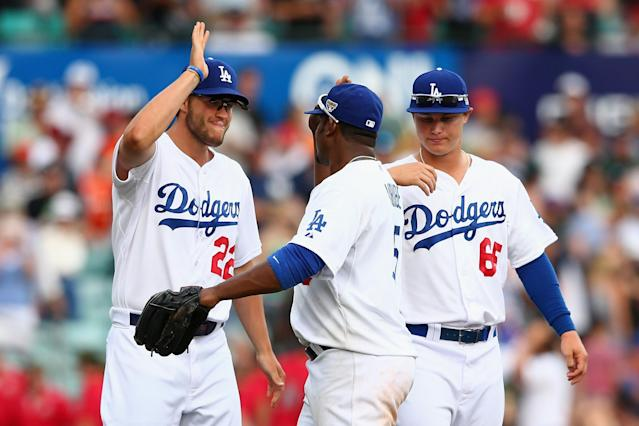 SYDNEY, AUSTRALIA - MARCH 23: Clayton Kershaw of the Dodgers celebrates with team mate Juan Uribe after winning the MLB match between the Los Angeles Dodgers and the Arizona Diamondbacks at Sydney Cricket Ground on March 23, 2014 in Sydney, Australia. (Photo by Cameron Spencer/Getty Images)