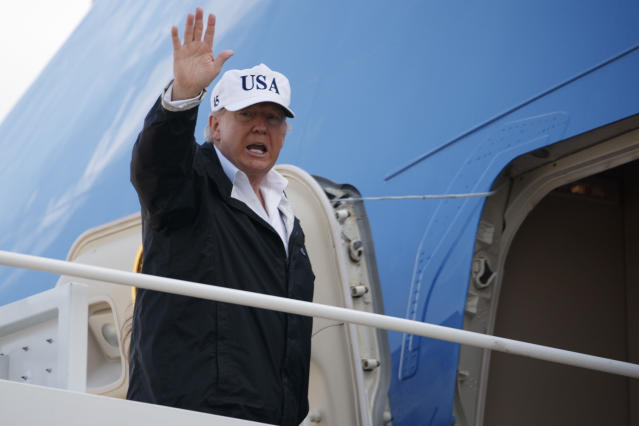 <p>President Donald Trump waves as he boards Air Force One for a trip to Florida to meet with first responders and people impacted by Hurricane Irma, Thursday, Sept. 14, 2017, in Andrews Air Force Base, Md. (Photo: Evan Vucci/AP) </p>