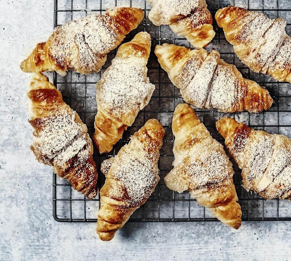 tray of croissants with powdered sugar