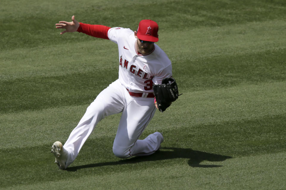 Los Angeles Angels right fielder Taylor Ward makes a sliding catch on a fly ball hit by Los Angeles Dodgers' Will Smith during the fifth inning of a baseball game in Anaheim, Calif., Sunday, May 9, 2021. (AP Photo/Alex Gallardo)
