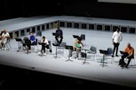 """In the pit, a jazz quartet rubs shoulders with a classical ensemble in Belgian composer Kris Defoort's """"The Time of Our Singing"""" based on the 2003 book of the same name by Richard Powers (AFP/François WALSCHAERTS)"""