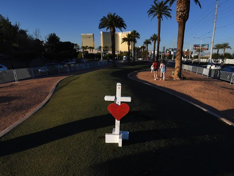 A solitary cross at a memorial site in front of the Mandalay Bay Hotel for the victims of the worst shooting in US history: Mark Ralson/AFP via Getty Images
