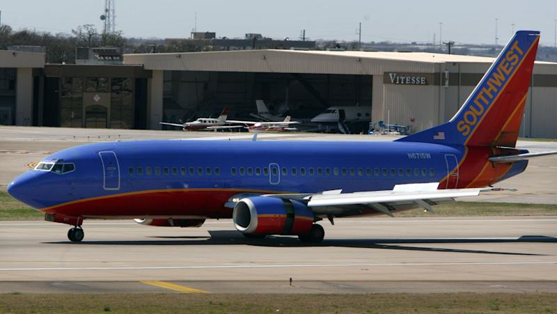 A Southwest Airlines plane taxis on the runway at airline's hub at Dallas Love Field March 12, 2008, in Dallas, Texas. (Photo by Rick Gershon/Getty Images)