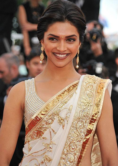 <b>5.Deepika Padukone:</b> Only someone as beautiful and elegant as this lady can pull off this boring colour without shunning away from the shutter bugs!