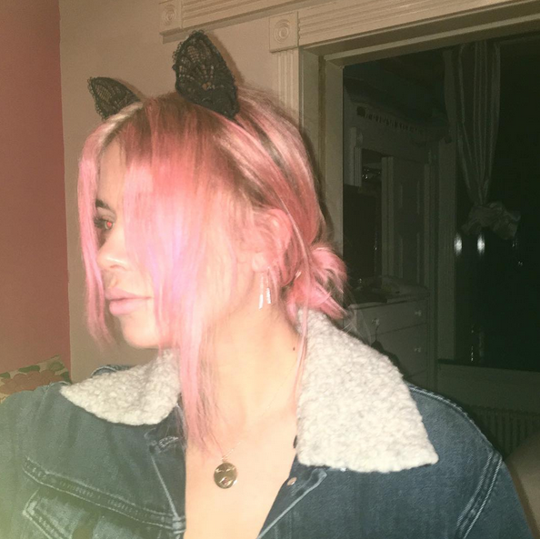 <p>The <i>Pretty Little Liars</i> star went pink with dark roots, pairing the look with a cat ear headband. (Photo: Instagram/Ashley Benson) </p>
