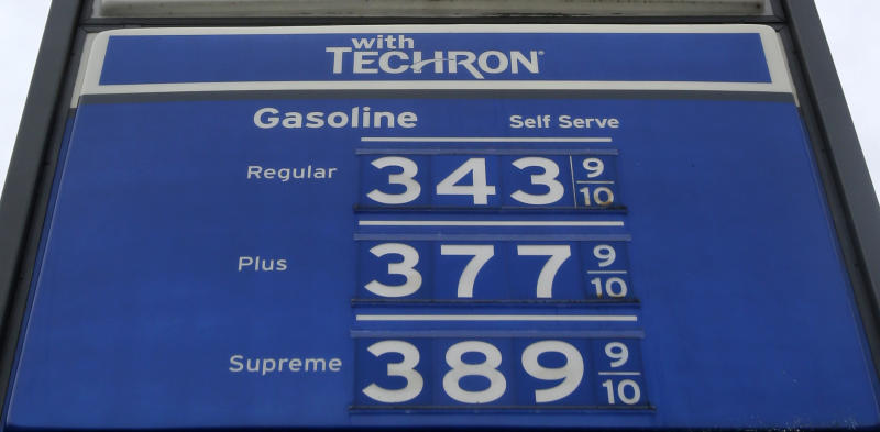 A sign with gas prices is shown at a gas station Monday, July 1, 2013, in Hialeah, Fla. Gasoline prices are on a summer slide, giving U.S. drivers a break as they set out for the beach and other vacation spots for the Fourth of July. (AP Photo/Alan Diaz)