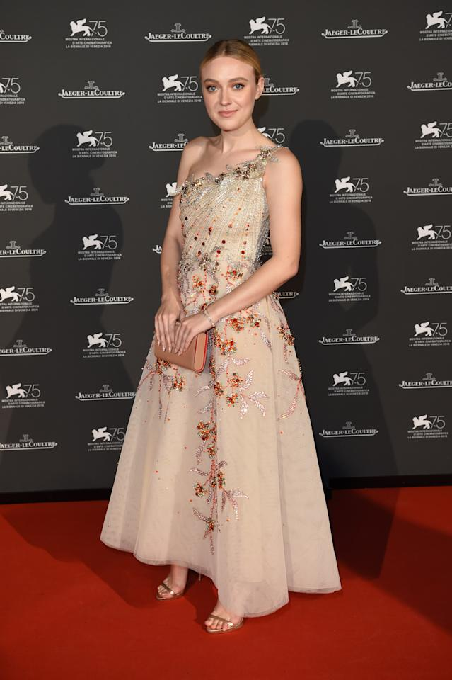 <p>Dakota paired her Jaeger-LeCoultre watch with a dress by Georges Hobeika. <em>[Photo: Getty]</em> </p>