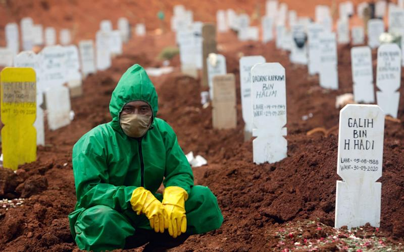 According to reports, the land at Pondok Ranggon Cemetery in Indonesia designated for the burial of people who died with Covid-19 is running low and is expected to run out within two months - Shutterstock