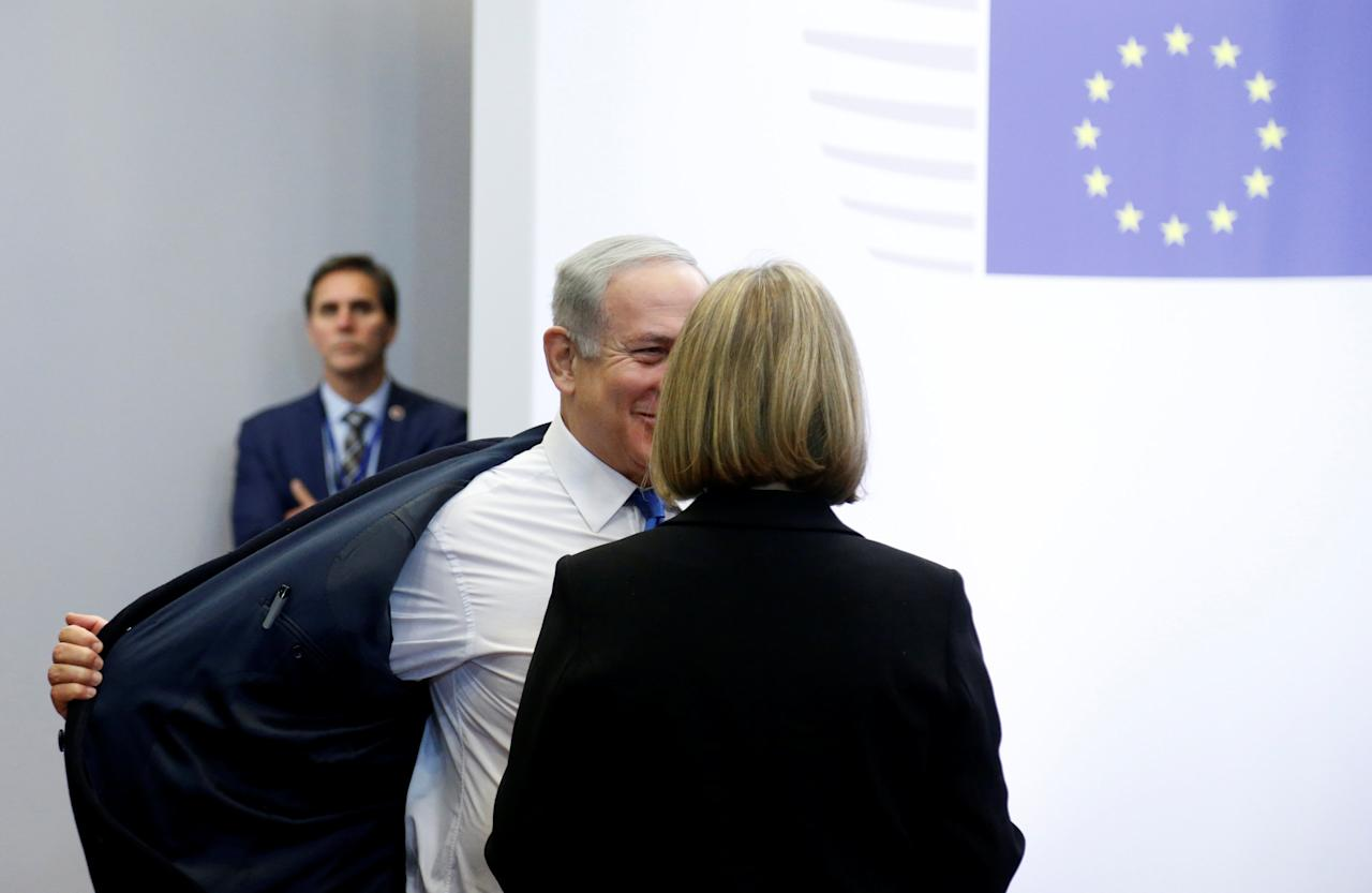 Israel's Prime Minister Benjamin Netanyahu is welcomed by European Union foreign policy chief Federica Mogherini at the European Council in Brussels, Belgium December 11, 2017.  REUTERS/Francois Lenoir