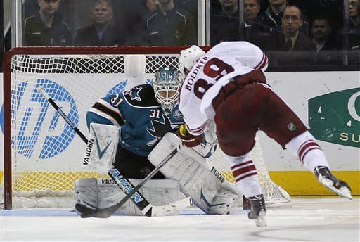 San Jose Sharks goalie Antti Niemi (31), of Finland, blocks a shot on goal against Phoenix Coyotes right wing Mikkel Boedker (89), from Denmark, during a shootout of an NHL hockey game in San Jose, Calif., Saturday, March 30, 2013. Sharks won 3-2 in a shootout. (AP Photo/Tony Avelar)