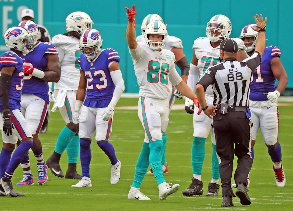 Miami Dolphins tight end Mike Gesicki (88) signals a first down on a pass reception in the first quarter against the Buffalo Bills on Sunday, September 20, 2020 at Hard Rock Stadium in Miami Gardens, Florida. (Charles Trainor Jr./Miami Herald/Tribune News Service via Getty Images)