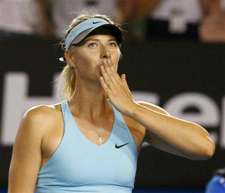 Maria Sharapova of Russia blows kisses to the crowd after defeating Bethanie Mattek-Sands of the United States in their women's singles match at the Australian Open 2014 tennis tournament in Melbourne January 14, 2014. REUTERS/Petar Kujundzic