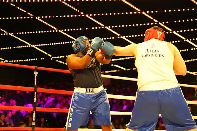 <p>Anthony P. (red) of the 50th Precinct in the Bronx fights fellow officer Rohan Lumsden (blue) in the 50th Precinct grudge match during the NYPD Boxing Championships at the Hulu Theater at Madison Square Garden on March 15, 2018. (Gordon Donovan/Yahoo News) </p>