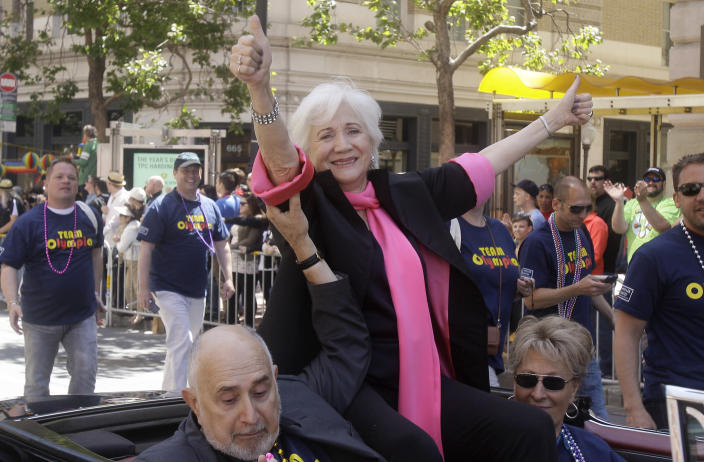 """FILE - In this June 26, 2011 file photo, Actress Olympia Dukakis, a celebrity Grand Marshall for the 41st annual Gay Pride parade, waves to the crowd while being driven past them in San Francisco. Olympia Dukakis, the veteran stage and screen actress whose flair for maternal roles helped her win an Oscar as Cher's mother in the romantic comedy """"Moonstruck,"""" has died. She was 89. (AP Photo/Jeff Chiu, File)"""