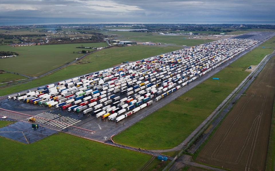 UK. Hundreds of trucks fill the runway at the former RAF airfield at Manston in Kent as the Port of Dover remains closed. France is among a number of countries to ban travel from the UK as Covid-19 infections rise dramatically and the possibility of a new mutant strain. - Peter Macdiarmid/LNP