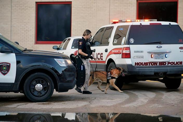 A Houston Independent School District Police K-9 unit responds to a shooting, Jan. 14 at Bellaire High School in Bellaire, Texas.