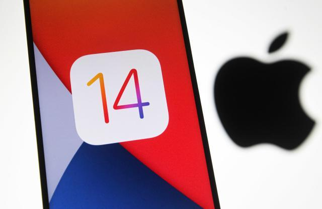 UKRAINE - 2020/10/14: In this photo illustration the iOS 14 logo of the iOS mobile operating system is seen displayed on a mobile phone with an Apple logo in the background. (Photo Illustration by Pavlo Gonchar/SOPA Images/LightRocket via Getty Images)