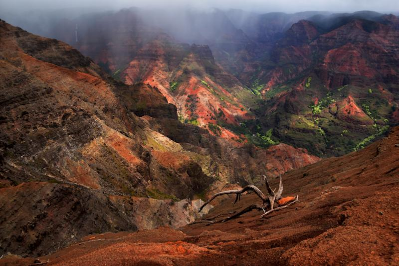 The view of majestic Waimea Canyon is a sight to behold. (Photo: Getty)