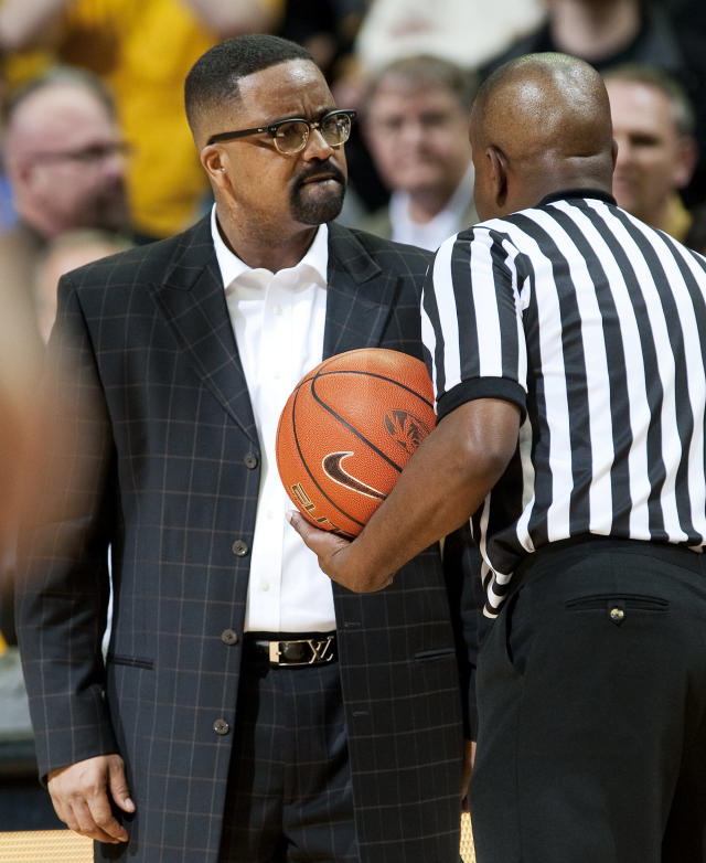 Missouri coach Frank Haith, left, discusses the decision of referee Pat Adams, right, after a video replay late in the second half of an NCAA college basketball game against Missouri on Wednesday, March 5, 2014, in Columbia, Mo. Missouri won 57-56. (AP Photo/L.G. Patterson)