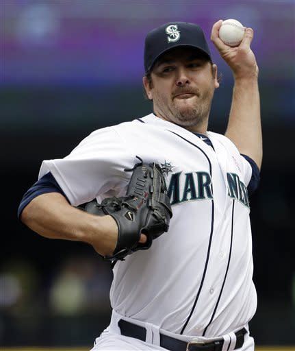 Seattle Mariners starting pitcher Joe Saunders throws against the Oakland Athletics in the first inning of a baseball game on Sunday, May 12, 2013, in Seattle. (AP Photo/Elaine Thompson)