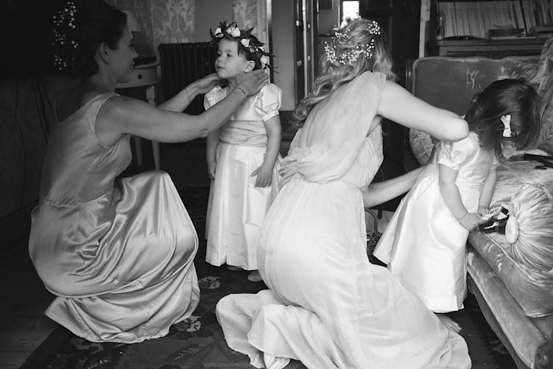 """My bridesmaids getting their little ones """"flower girl"""" ready. The floral garlands were made by a local florist."""