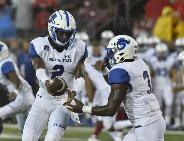 Indiana State quarterback Jalil Kilpatrick (2) hands the ball off to Indiana State running back Ja'Quan Keys (3) during the first half of an NCAA college football game against Louisville, Saturday, Sept. 8, 2018, in Louisville, Ky. (AP Photo/Timothy D. Easley)