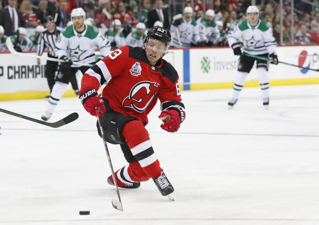 New Jersey Devils left wing Jesper Bratt (63) plays the puck against the Dallas Stars during the second period of an NHL hockey game Saturday, Feb. 1, 2020, in Newark,N.J. (AP Photo/Noah K. Murray)