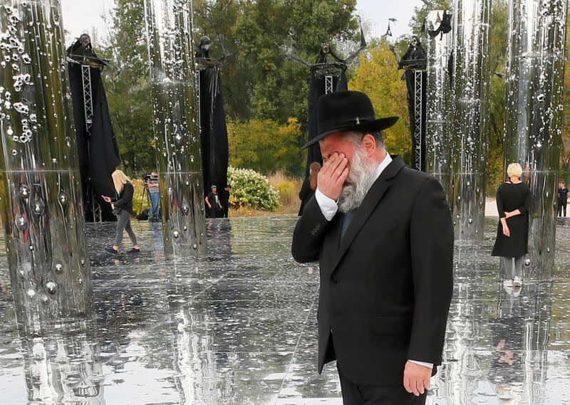 FILE PHOTO: A Jewish man reacts during the opening ceremony of an installation commemorating the victims of Babyn Yar in Kyiv