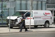 <p>A rented van sits on a sidewalk about a mile from where several pedestrians were injured in northern Toronto, Canada, 23 April 2018. Eight to ten people were struck in two locations. Police took the driver into custody. EPA/WARREN TODA </p>