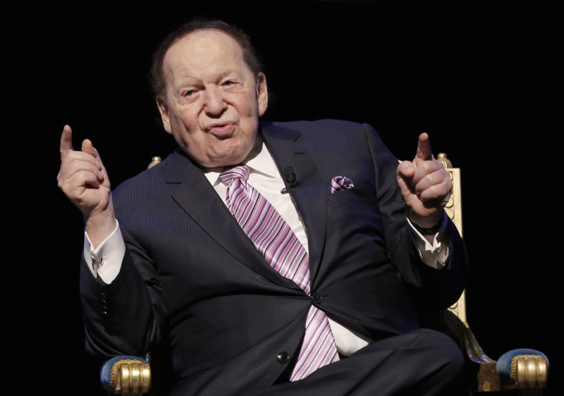 FILE - In this Sept. 13, 2016 file photo, U.S. billionaire Sheldon Adelson speaks during a news conference for the opening of Parisian Macao in Macau. A jury is set to decide how much Las Vegas Sands Corp. has to pay to a Hong Kong businessman for helping the company open its first Macau resort. Attorneys for Richard Suen and Sands are to provide trial overviews Wednesday, March 13, 2019. Adelson isn't expected to testify, he's battling cancer. (AP Photo/Kin Cheung, File)