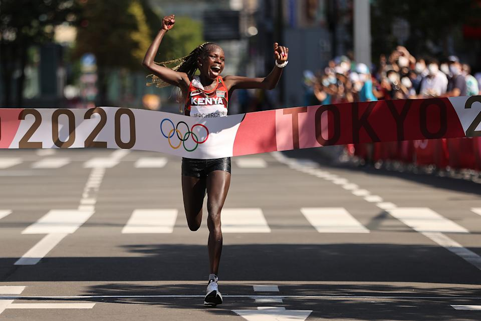 SAPPORO, JAPAN - AUGUST 07: Peres Jepchirchir of Team Kenya celebrates as she crosses the finish line to win the gold medal in the Women's Marathon Final on day fifteen of the Tokyo 2020 Olympic Games at Sapporo Odori Park on August 7, 2021 in Sapporo, Japan. (Photo by Clive Brunskill/Getty Images)