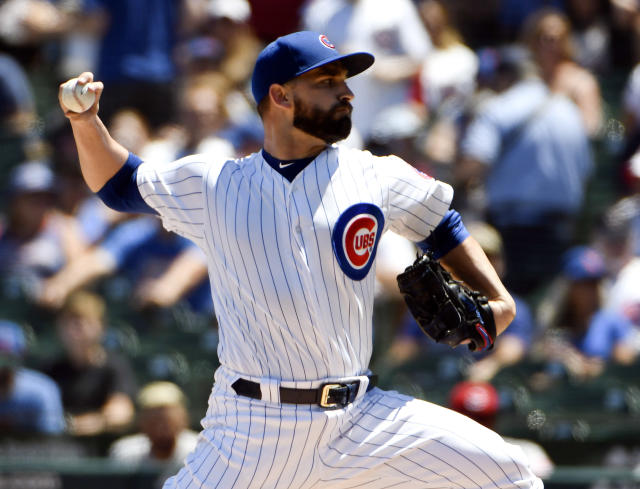 Chicago Cubs starting pitcher Tyler Chatwood (21) throws against the Cincinnati Reds during the first inning of a baseball game Saturday, July 7, 2018, in Chicago. (AP Photo/David Banks)