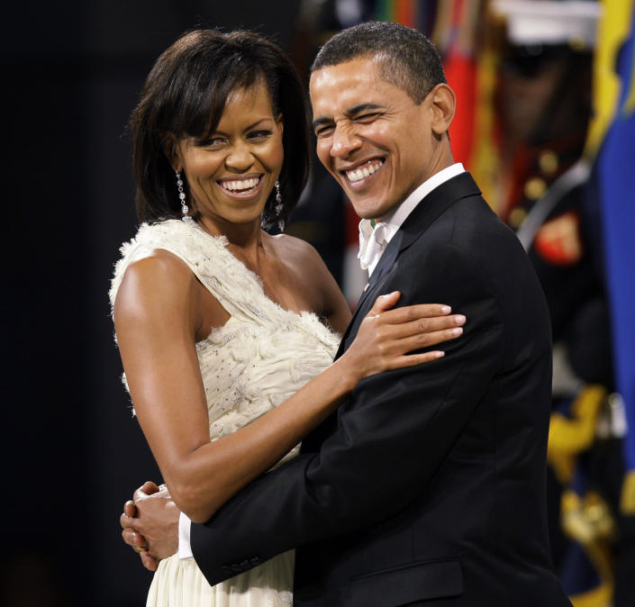 """""""The gray is coming quick…By the time I'm sworn in, I will look the part,"""" then president-elect told supporters in July 2008. Here, he and first lady Michelle Obama dance at the Western Inaugural Ball on Jan. 20, 2009. (AP Photo/Charlie Neibergall, File)"""