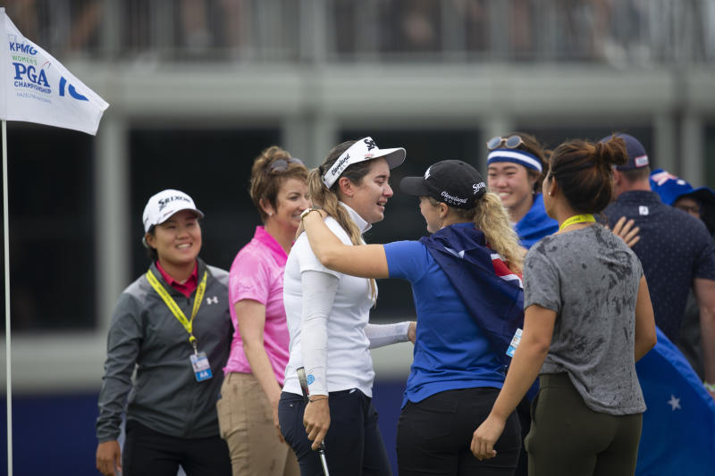 Hannah Green, of Australia, is overcome with emotions as she is congratulated by Australian fans after winning the KPMG Women's PGA Championship golf tournament, Sunday, June 23, 2019, in Chaska, Minn. (AP Photo/Andy Clayton-King)
