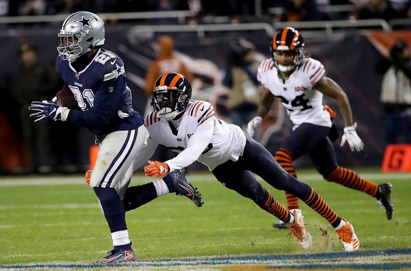 CHICAGO, ILLINOIS - DECEMBER 05: Running back Ezekiel Elliott #21 of the Dallas Cowboys carries the ball against the defense of free safety Eddie Jackson #39 of the Chicago Bears during the game at Soldier Field on December 05, 2019 in Chicago, Illinois. (Photo by Jonathan Daniel/Getty Images)