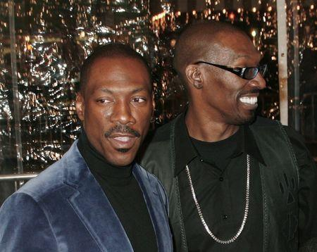 "Actor Eddie Murphy (L), star of the comedy ""Norbit"", poses with his older brother Charlie Murphy as they arrive at the film's premiere in Los Angeles February 8, 2007. REUTERS/Fred Prouser"