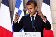 French President Emmanuel Macron speaks during the signing of a new defense deal at The Elysee Palace Tuesday, Sept. 28, 2021 in Paris. France and Greece announced on Tuesday a major, multibillion-euro defense deal including Athens' decision to buy three French warships. (Ludovic Marin, Pool Photo via AP)