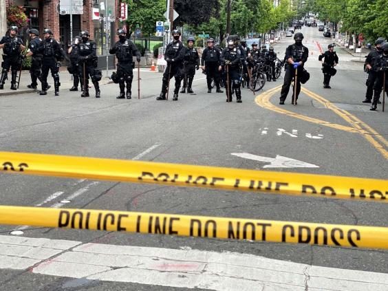 Police officers work to clear Seattle's CHOP (Rex Features)