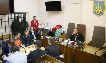 Head of Ukraine's tax and customs service Roman Nasirov (4th L), who is under investigation over the suspected embezzlement, attends a court hearing in Kiev, Ukraine, March 6, 2017. REUTERS/Valentyn Ogirenko