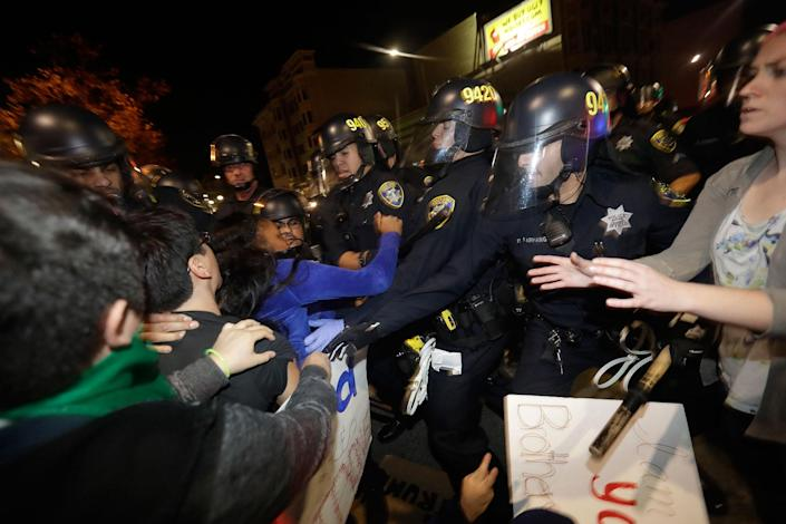 <p>Protesters clash with police Wednesday, Nov. 9, 2016, in Oakland, Calif. Police in Oakland blocked thousands of people protesting Donald Trump's election from getting onto a highway Wednesday night. The crowd chanting and waving signs gathered in Frank Ogawa Plaza in downtown Oakland in the afternoon. (Photo: Marcio Jose Sanchez/AP) </p>