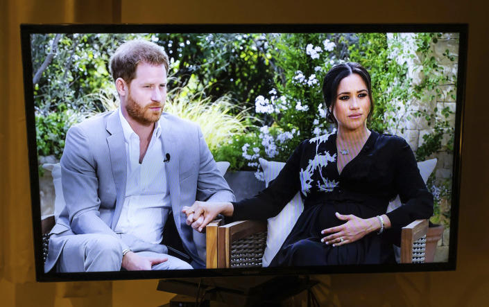 Photo by: zz/KGC-254/STAR MAX/IPx 2021 3/8/21 A Londoner watches the live ITV UK television broadcast of Oprah Winfrey's interview wih Prince Harry The Duke of Sussex and Meghan Markle The Duchess of Sussex taped in Los Angeles, California.