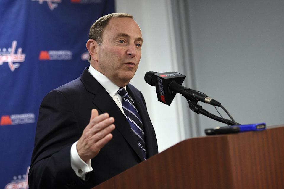NHL commissioner Gary Bettman speaks to reporters before an NHL hockey game between the Pittsburgh Penguins and the Washington Capitals, Wednesday, Feb. 25, 2015, in Washington. (AP Photo/Nick Wass)