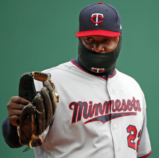 Minnesota Twins third baseman Miguel Sano waves his glove to a fan during a baseball game against the Pittsburgh Pirates in Pittsburgh, Monday, April 2, 2018. (AP Photo/Gene J. Puskar)