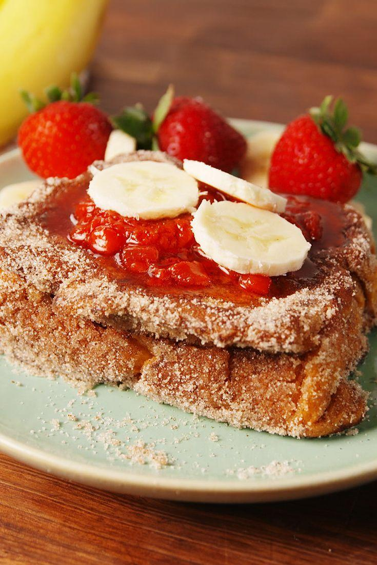 """<p>Bananas and strawberries are always welcome at breakfast-time, but pair them with cinnamon-scented French toast and you're really having a special breakfast. </p><p>Get the recipe from <a href=""""https://www.oprahdaily.com/cooking/recipe-ideas/recipes/a54151/tonga-toast-recipe/"""" rel=""""nofollow noopener"""" target=""""_blank"""" data-ylk=""""slk:Delish"""" class=""""link rapid-noclick-resp"""">Delish</a>.</p>"""