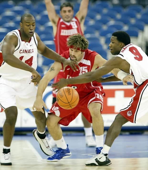 Meeks, left, and Rowan Barrett, right, compete at the 2002 FIBA world championships.