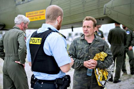Danish submarine owner and inventor Peter Madsen lands with the help of the Danish defence in Dragor Harbor south of Copenhagen, Denmark August 11, 2017. Scanpix Denmark/Bax Lindhardt/via REUTERS